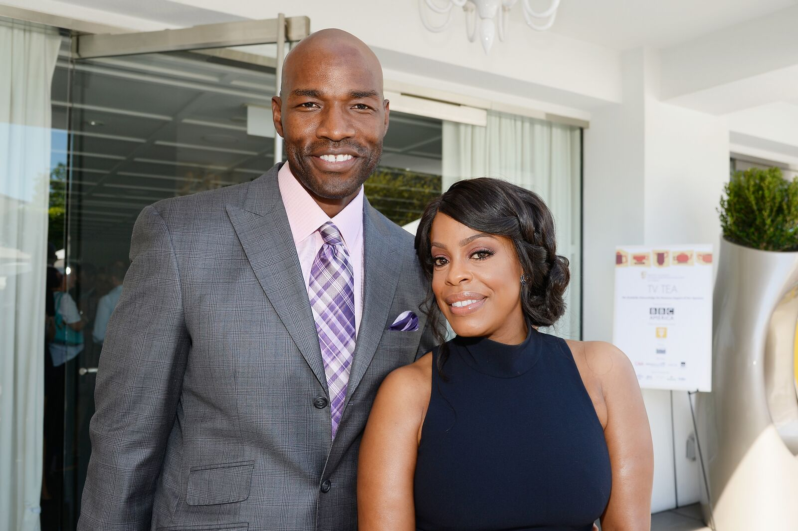 Jay Tucker (L) and actress Niecy Nash attend the 2015 BAFTA Los Angeles TV Tea at SLS Hotel on September 19, 2015 | Photo: Getty Images