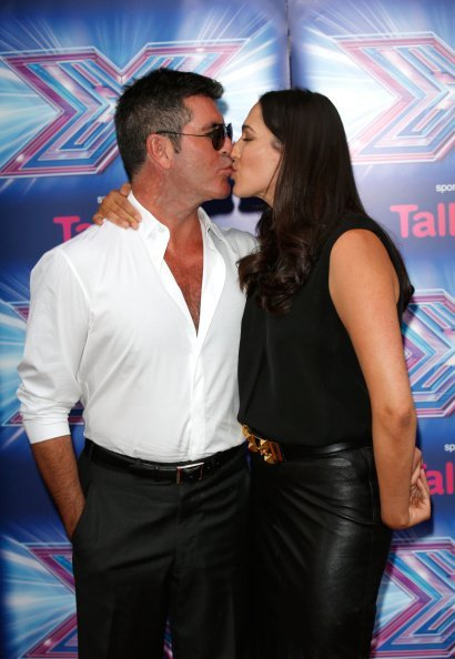 "Simon Cowell and Lauren Silverman attend the press launch for the new series of ""The X Factor"" at Ham Yard Hotel on August 27, 2014, in London, England. 