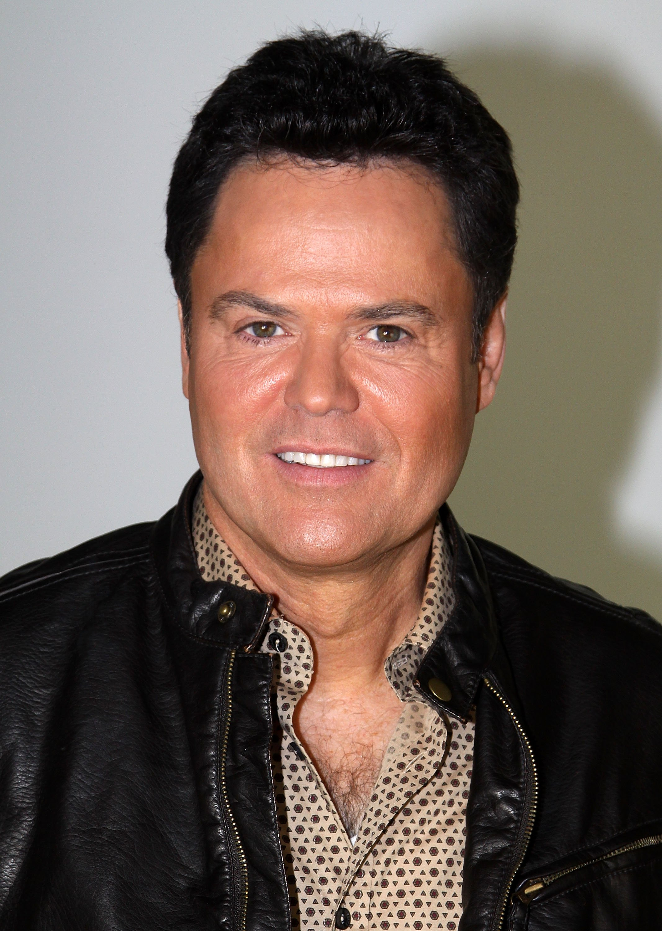 """Donny Osmond poses as he promotes """"A Broadway Christmas"""" at The Broadway.com Studios. 