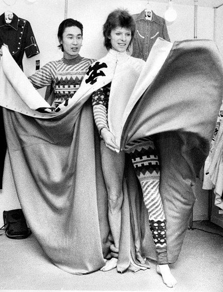 David Bowie attends a costume fitting session with Kansai Yamamoto ahead of his performance on April 7, 1973 in Tokyo, Japan. | Photo: Getty Images