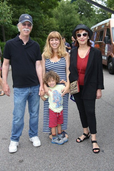 Steve Janowitz, Joy Behar with her daughter Eve Behar and grandson Luca at the 6th Annual Family Affair on July 19, 2014 | Photo: Getty Images