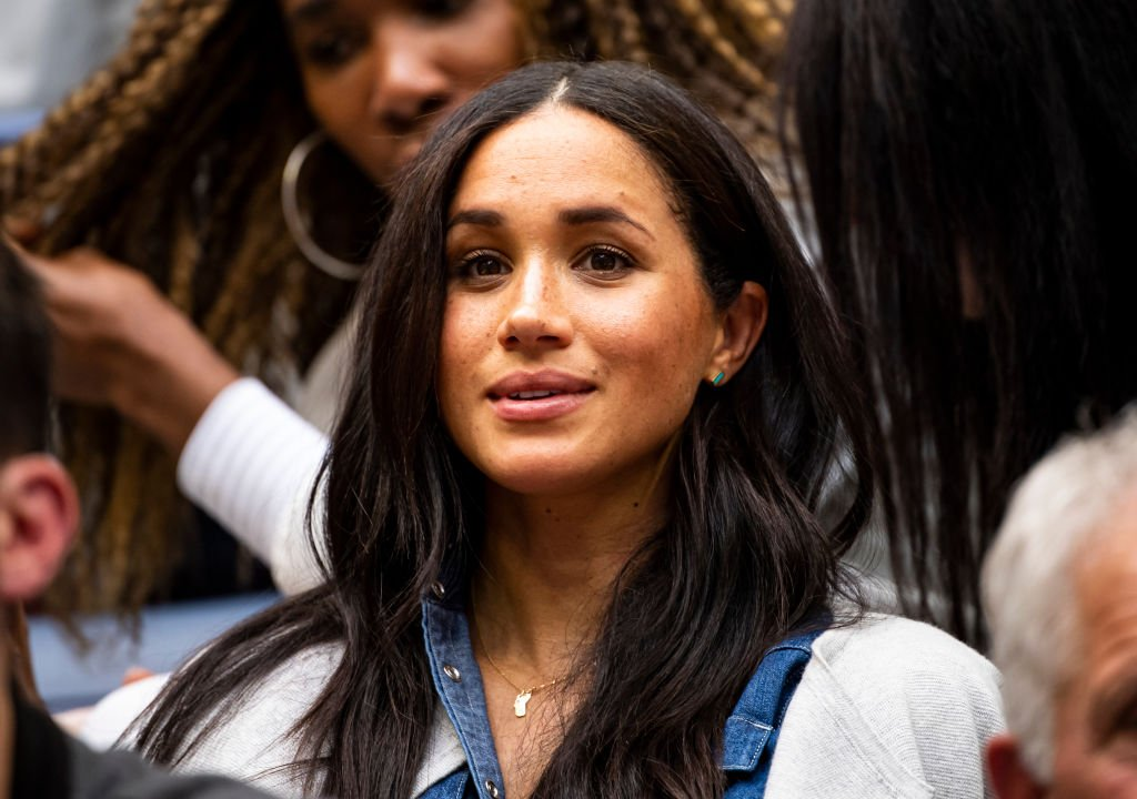 Megan Markle, The Duchess of Sussex, watches Serena Williams of the United States in action against Bianca Andreescu of Canada at Arthur Ashe Stadium at the USTA Billie Jean King National Tennis Center | Photo: Getty Images