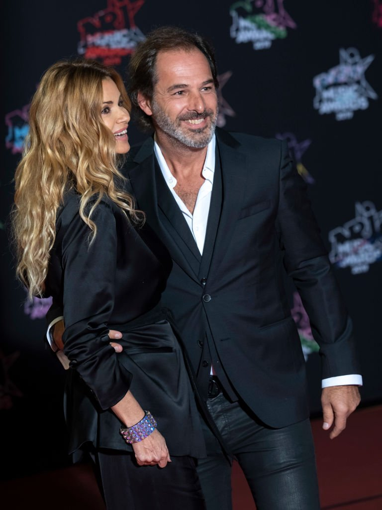 Ingrid Chauvin et Thierry Peythieu assistent à la 21e NRJ Music Awards au Palais des Festivals le 09 novembre 2019 à Cannes, France. | Photo : Getty Images