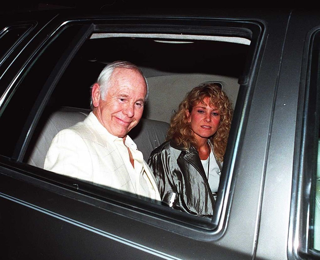 Johnny Carson and wife Alexis Leave Spago Restaurant After Dinner, August 11 1994 | Photo: GettyImages