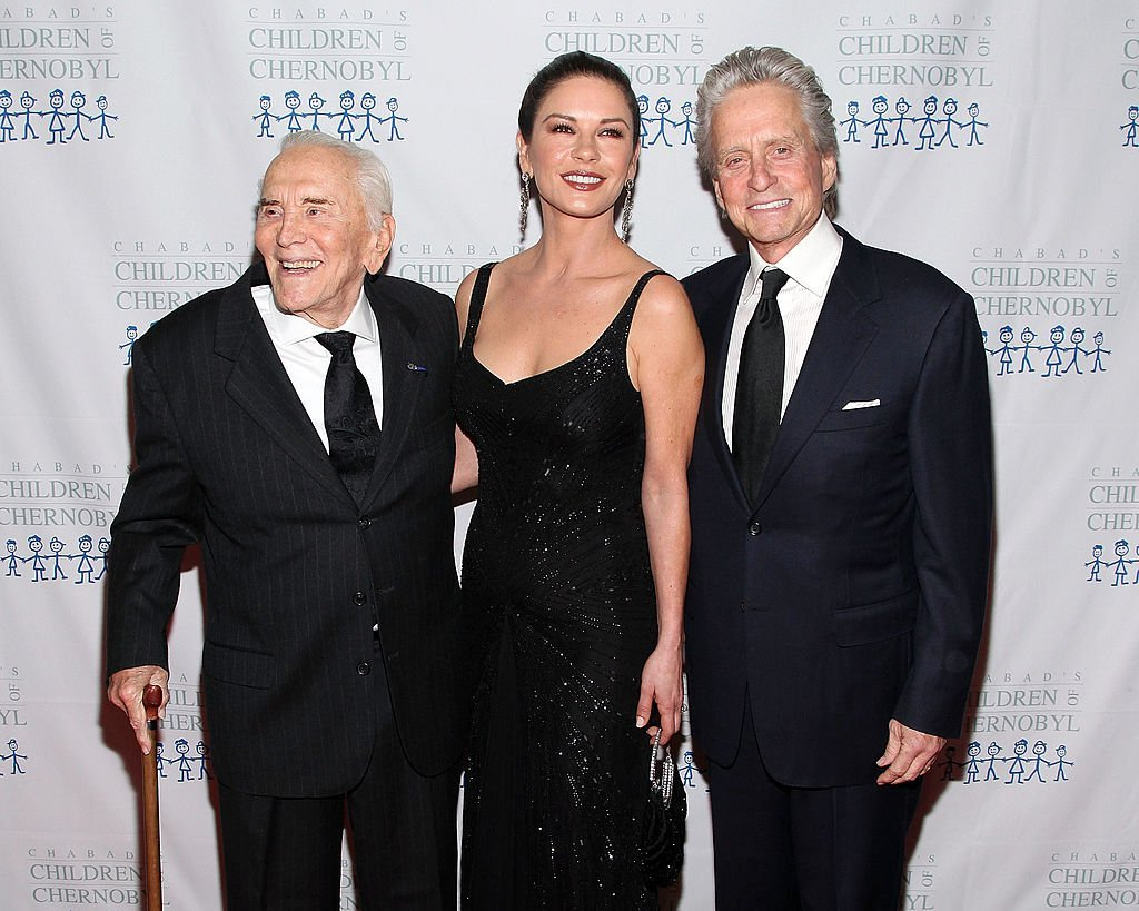 Kirk Douglas, Catherine Zeta-Jones, and Michael Douglas at the 2011 Children of Chernobyl's Children, at Heart gala at the Chelsea Piers on November 21, 2011. | Source: Getty Images