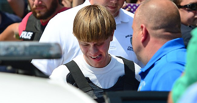 Charleston shooting suspect Dylann Roof is escorted from the Shelby Police Dept. on Thursday, June 18, 2015   Photo: Getty Images