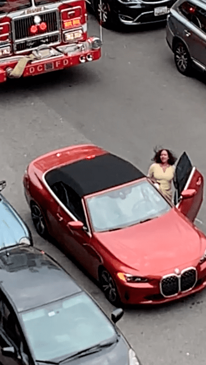 A woman entering her car, which blocked the road.   Source: Reddit.com/MrJackDog