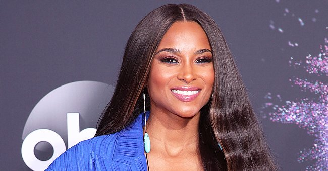 Ciara Looks Stunning Showing Weight Loss in a Blue Swimsuit with a Deep Neckline during a Trip