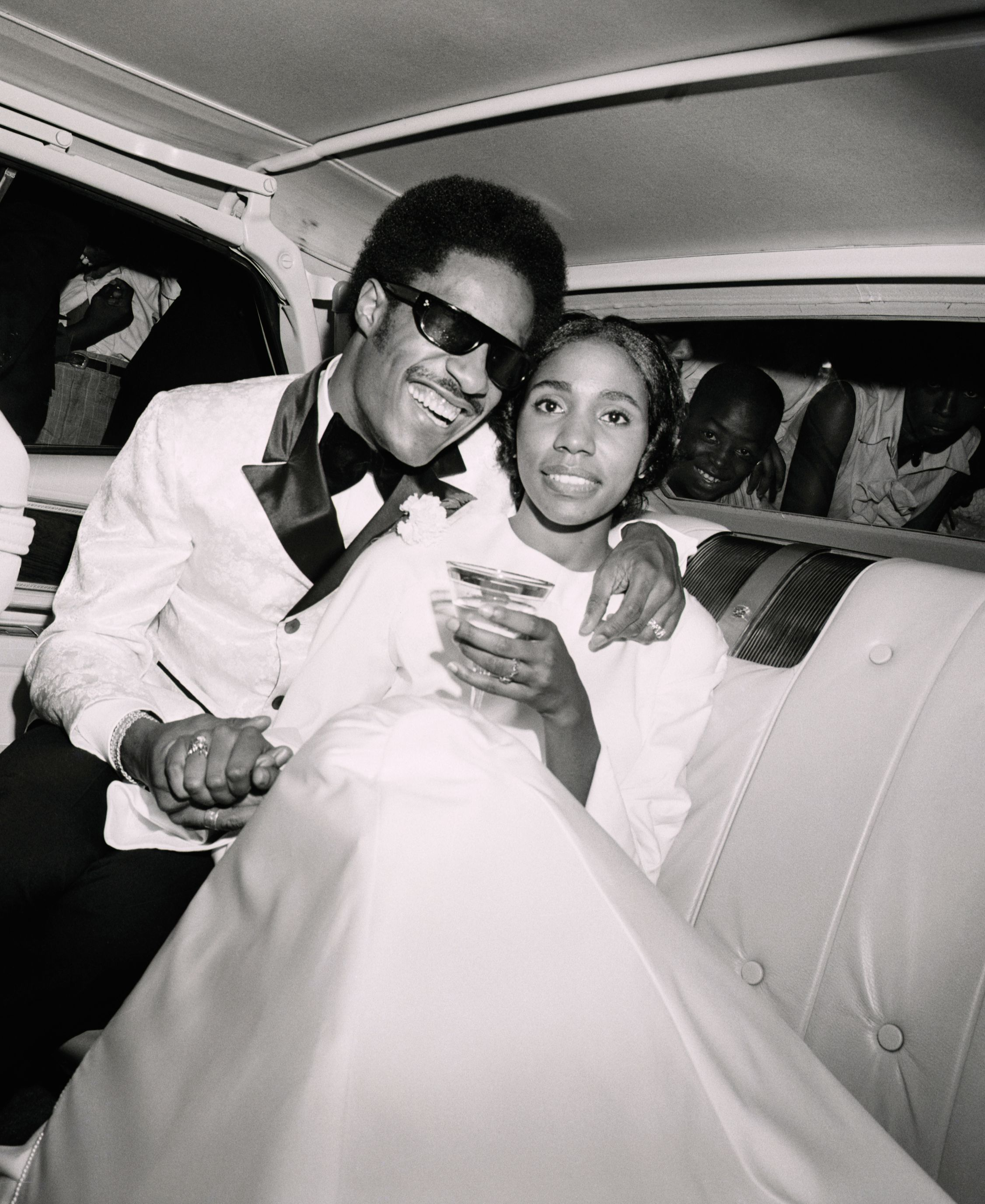 Stevie Wonder and Syreeta Wright following their wedding ceremony at the Detroit Bernette Baptist Church in 1970   Source: Getty Images