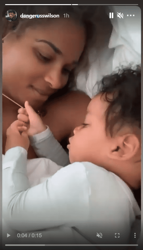 A screenshot of Ciara's son, Win, playing with her necklace on Instagram | Photo: Instagram/dangerusswilson