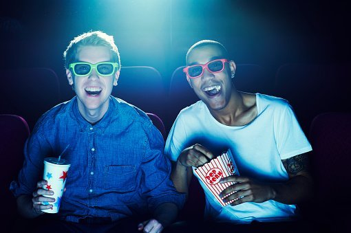 Photo of two friends at the cinema wearing 3D glasses | Photo: Getty Images