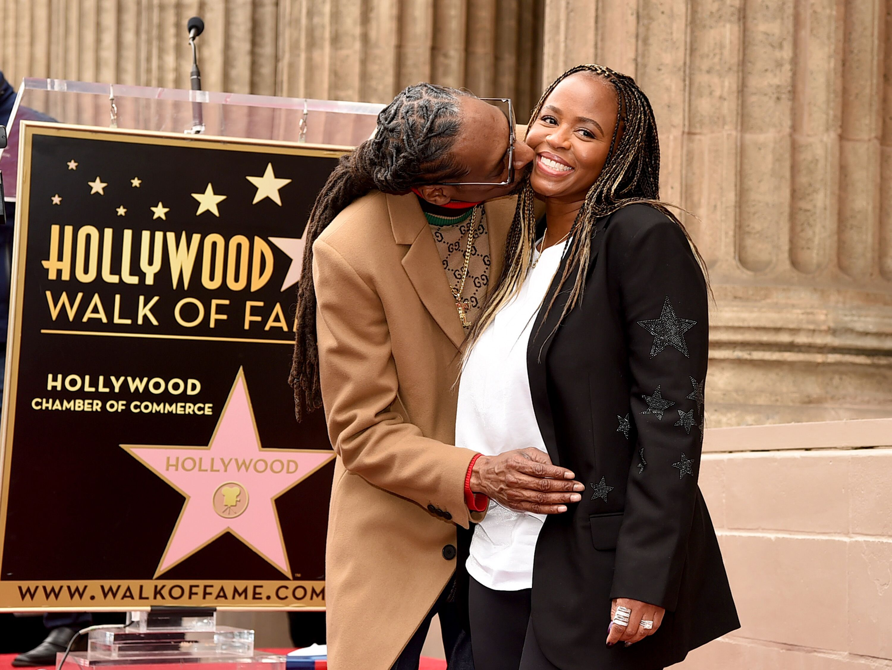 Shante Broadus and husband Snoop Dogg on the Hollywood Walk of Fame/ Source: Getty Images