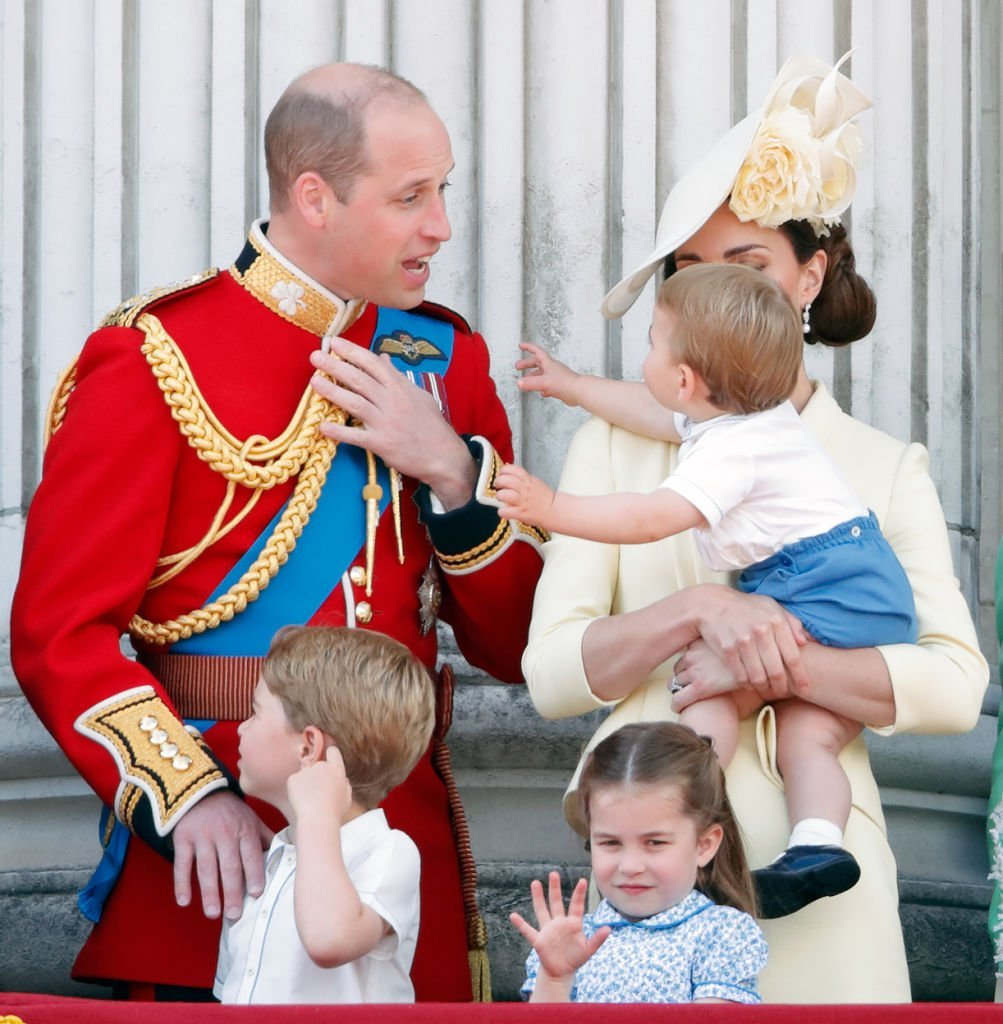 Prince William, Duke of Cambridge, Catherine, Duchess of Cambridge, Prince Louis of Cambridge, Prince George of Cambridge and Princess Charlotte of Cambridge on the balcony of Buckingham Palace during Trooping The Colour, the Queen's annual birthday parade | Photo: Getty Images