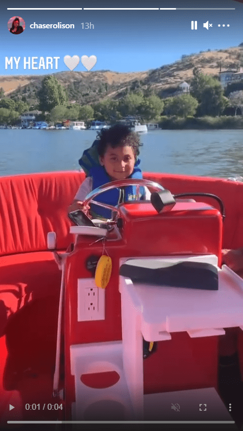 """TLC singer Tionne """"T-Boz"""" Watkin's son Chance seen riding on a boat while wearing a life jacket   Photo: Instagram/chaserolison"""