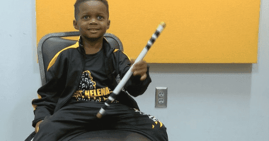 Drumming prodigy Jeremiah Travis with his drumstick. | Photo: twitter/wave3news