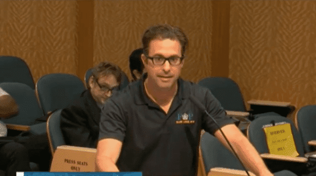A screenshot of Captain Javier Ortiz during a hearing with commissioners where he admitted he was Black. | Photo: Youtube/cbsmiami