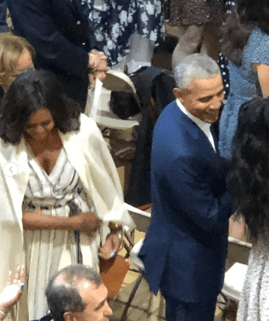 Barack and Michelle Obama mingling with other guests at their daughter Sasha Obama's high school graduation at Sidwell High School. | Source: Instagram/kceesq