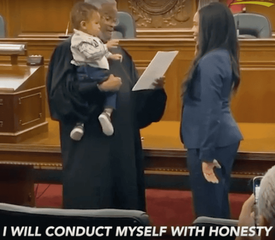 Judge Richard Dinkins holds one-year-old Beckham as the boy's mother, Julianna Lamar is sworn in. | Screenshot: YouTube/goodmorningamerica