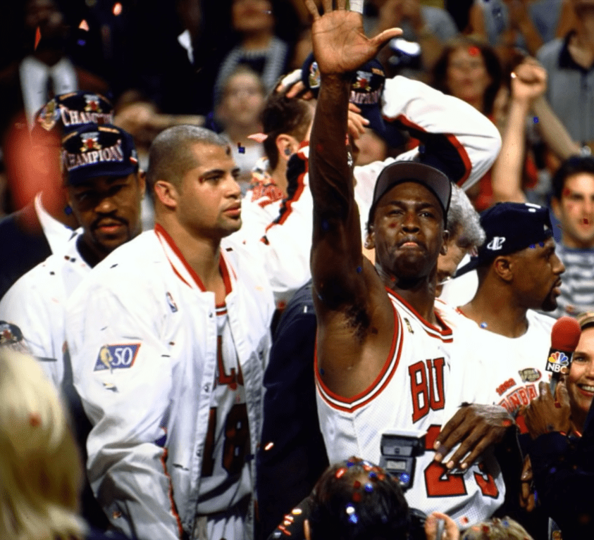 Bison Dele and Michael Jordan after winning an NBA Championship in 1997   Photo: YouTube/NBA Insider