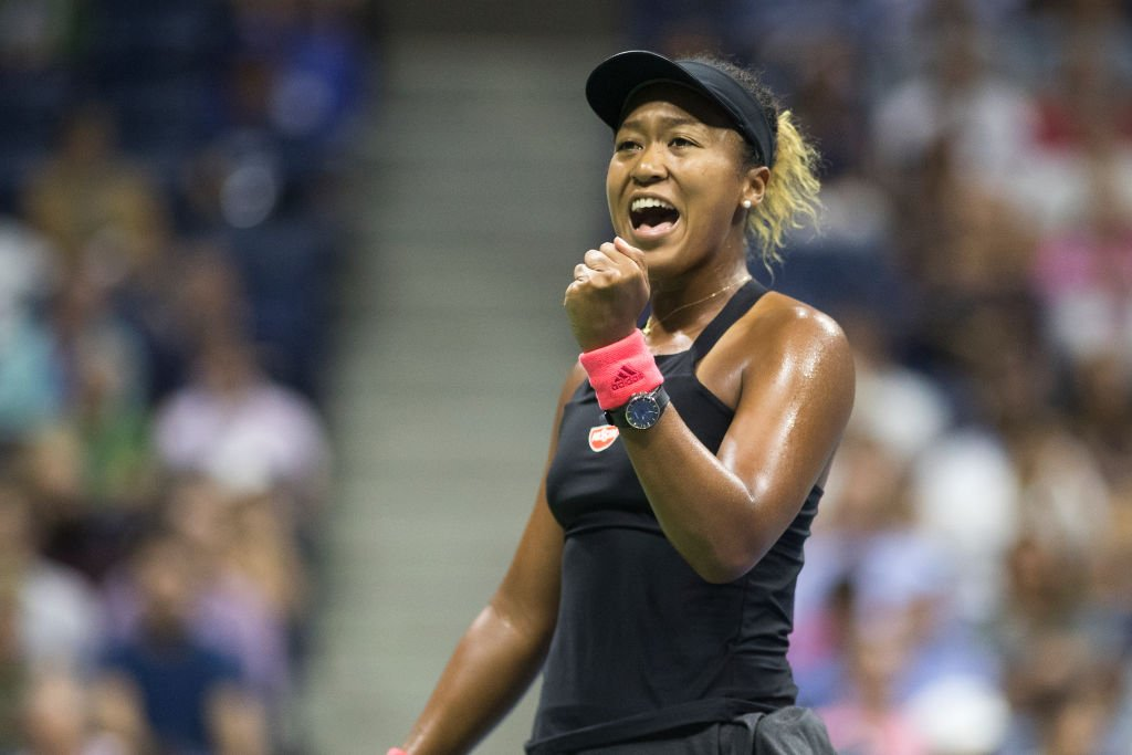 Tennis champion Naomi Osaka celebrates victory during the 2018 US Open Tennis Tournament in New York City. | Photo: Getty Images