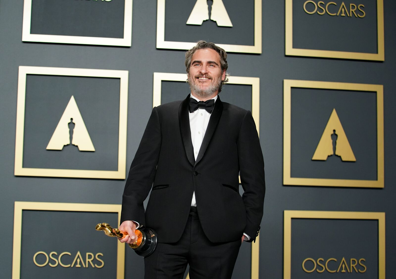 Joaquin Phoenix poses in the press room during the 92nd Annual Academy Awards on February 09, 2020, in Hollywood, California | Photo: Rachel Luna/Getty Images
