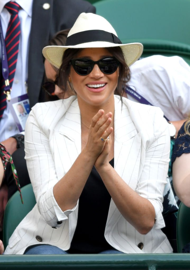 Meghan, Duchess of Sussex smiles as she attends day 4 of the Wimbledon Tennis Championships at the All England Lawn Tennis and Croquet Club | Photo: Getty Images