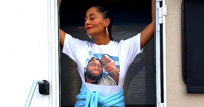 Tracee Ellis Ross Poses Barefoot in a Gorgeous Photo Wearing a Yellow Top & Blue Skirt