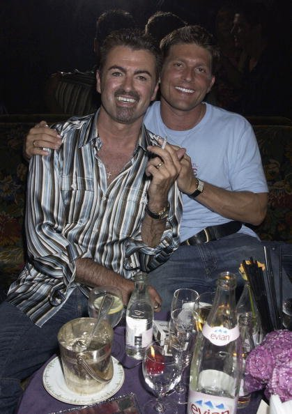 George Michael and Kenny Goss at The Ritz Hotel on 9th July 2002, in Paris.   Photo: Getty Images