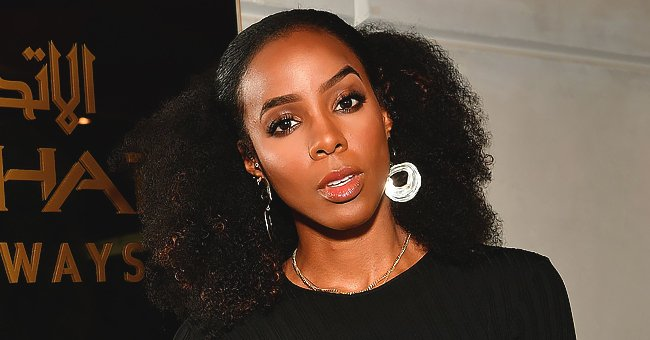 Kelly Rowland Flashes White Smile & Poses in a Tight Black Dress as She Teases New Project