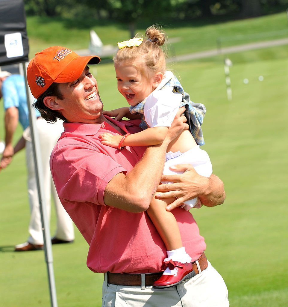 Donald Trump Jr.and his 3 year old daughter Kai Madison Trump attend the 3rd annual Eric Trump Foundation Golf Invitational at the Trump National Golf Club Westchester | Photo: Getty Images
