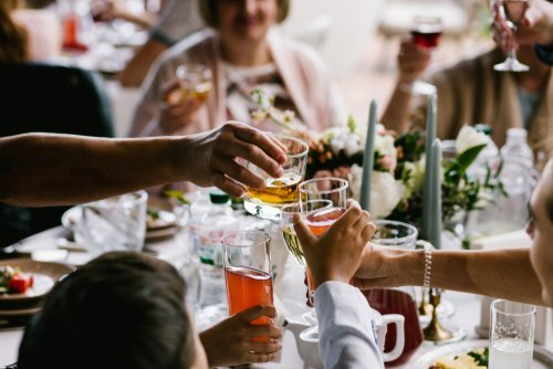 Guests enjoying a dinner party. | Source: Shutterstock.