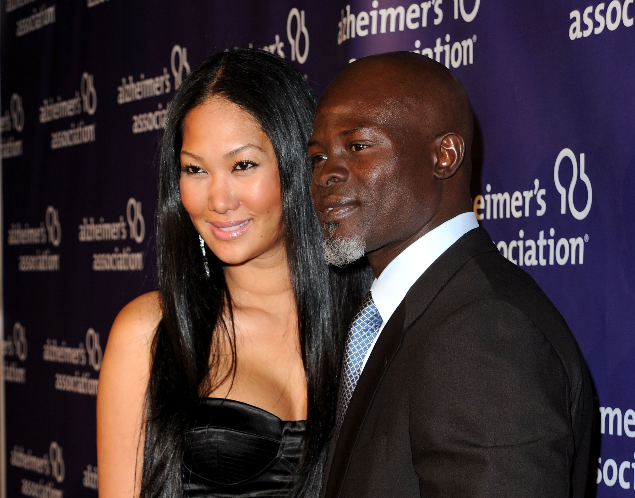 Djimon Hounsouand Kimora Lee Simmons at a Alzheimer's Association event/ Source: Getty Images
