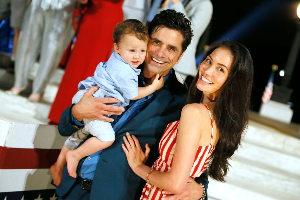 John Stamos & wife Caitlin McHugh with their son Billy Stamos during 'A Capitol Fourth' on July 04, 2019 in Washington, DC. |Photo: Getty Images