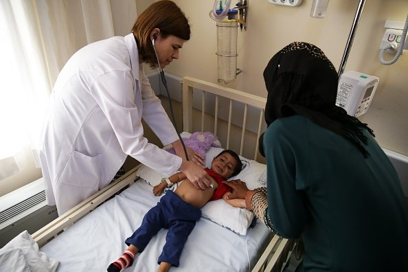 Photo of a Doctor examining a young child | Photo: Getty Images