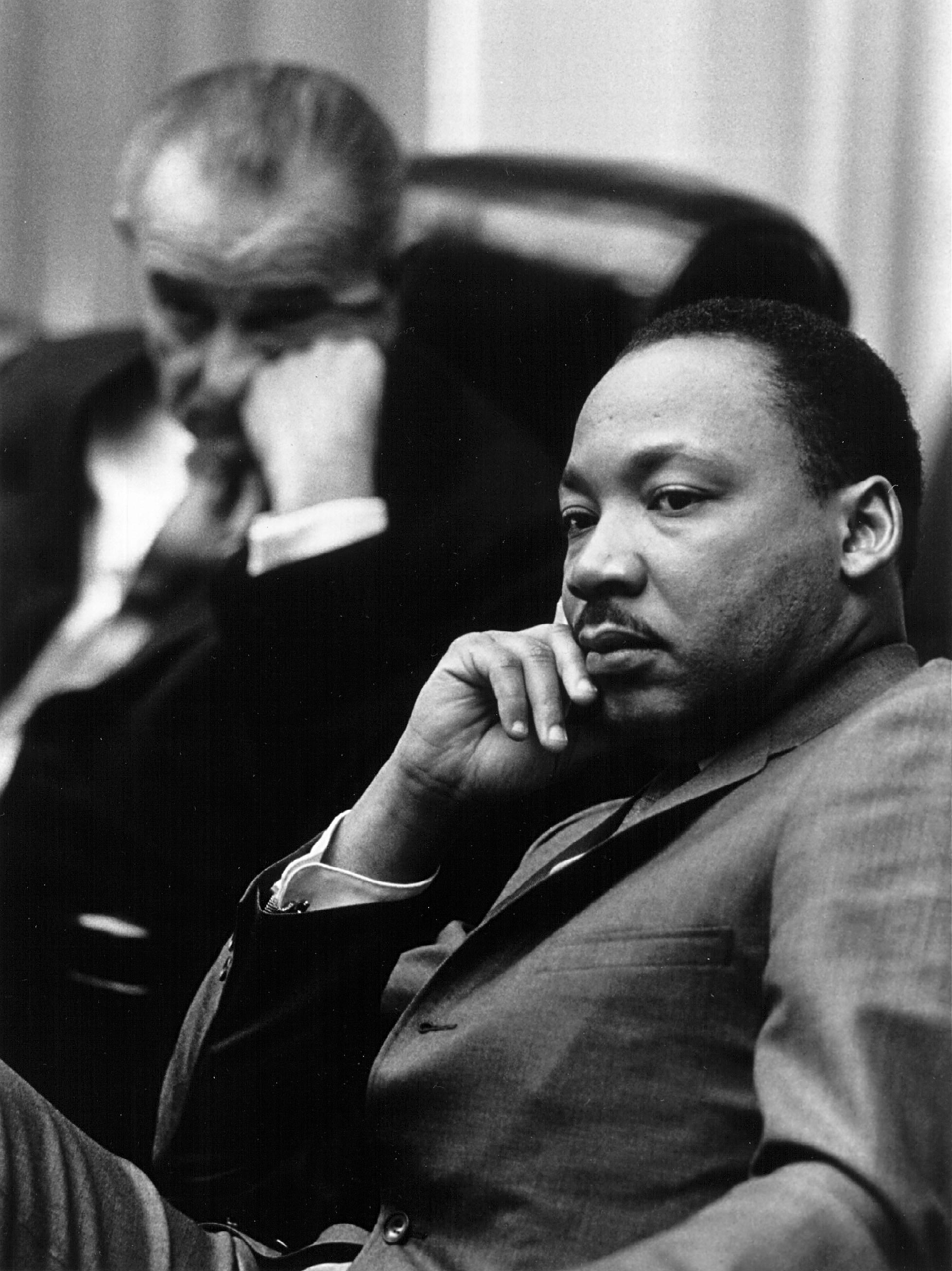 Rev. Martin Luther King Jr. with President Lyndon B. Johnson in the background March 18, 1966 at the White House. | Photo: GettyImages