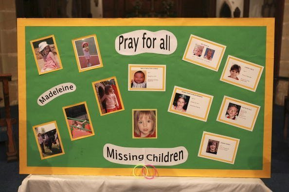 A board with photographs of missing Madeline McCann and other missing children made by a parishoner