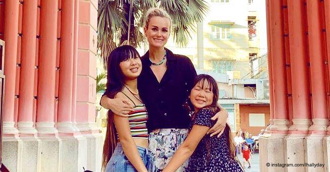 Laeticia Hallyday montre une vidéo avec une orpheline dans les bras et partage son succès au Vietnam