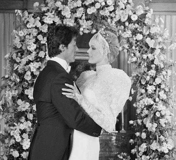 Sylvester Stallone and Brigitte Nielsen at their wedding ceremony at the home of Rocky producer, Irwin Winkler | Photo: Getty Images