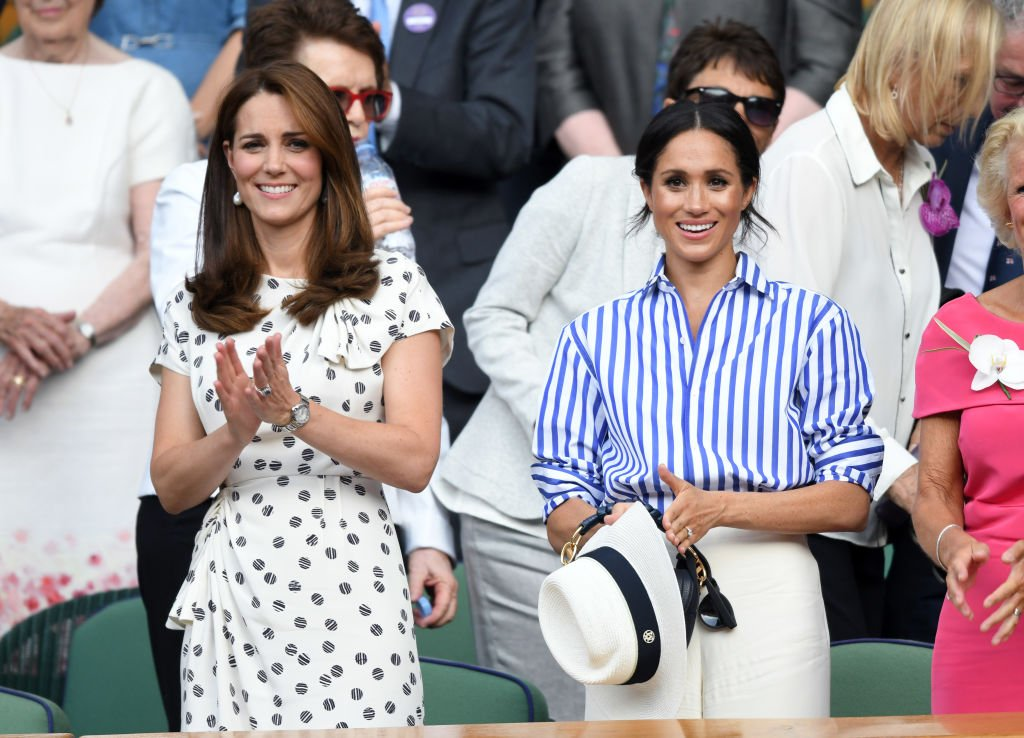 Kate Middleton and Meghan Markle at the Wimbledon Tennis Championships at the All England Lawn Tennis and Croquet Club on July 14, 2018 in London, England. | Photo: Getty Images
