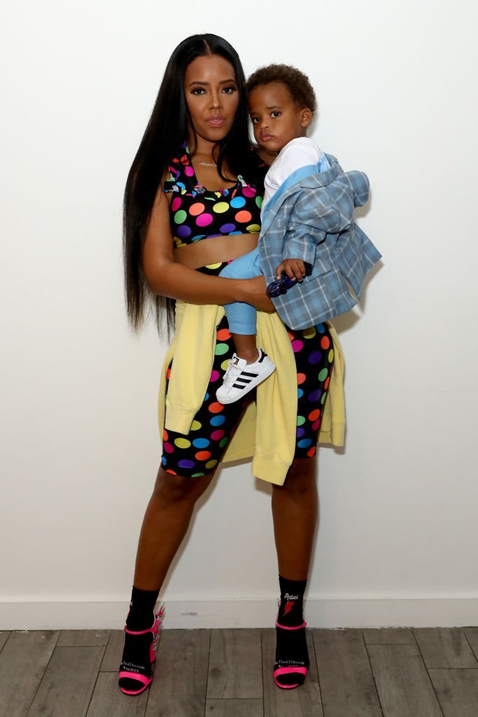 Fashion designer Angela Simmons (L) and her son Sutton Joseph Tennyson pose backstage as STYLE360 hosts Bonnie Bouche by Angela Simmons sponsored by Skechers D'Lites | Photo: Getty Images