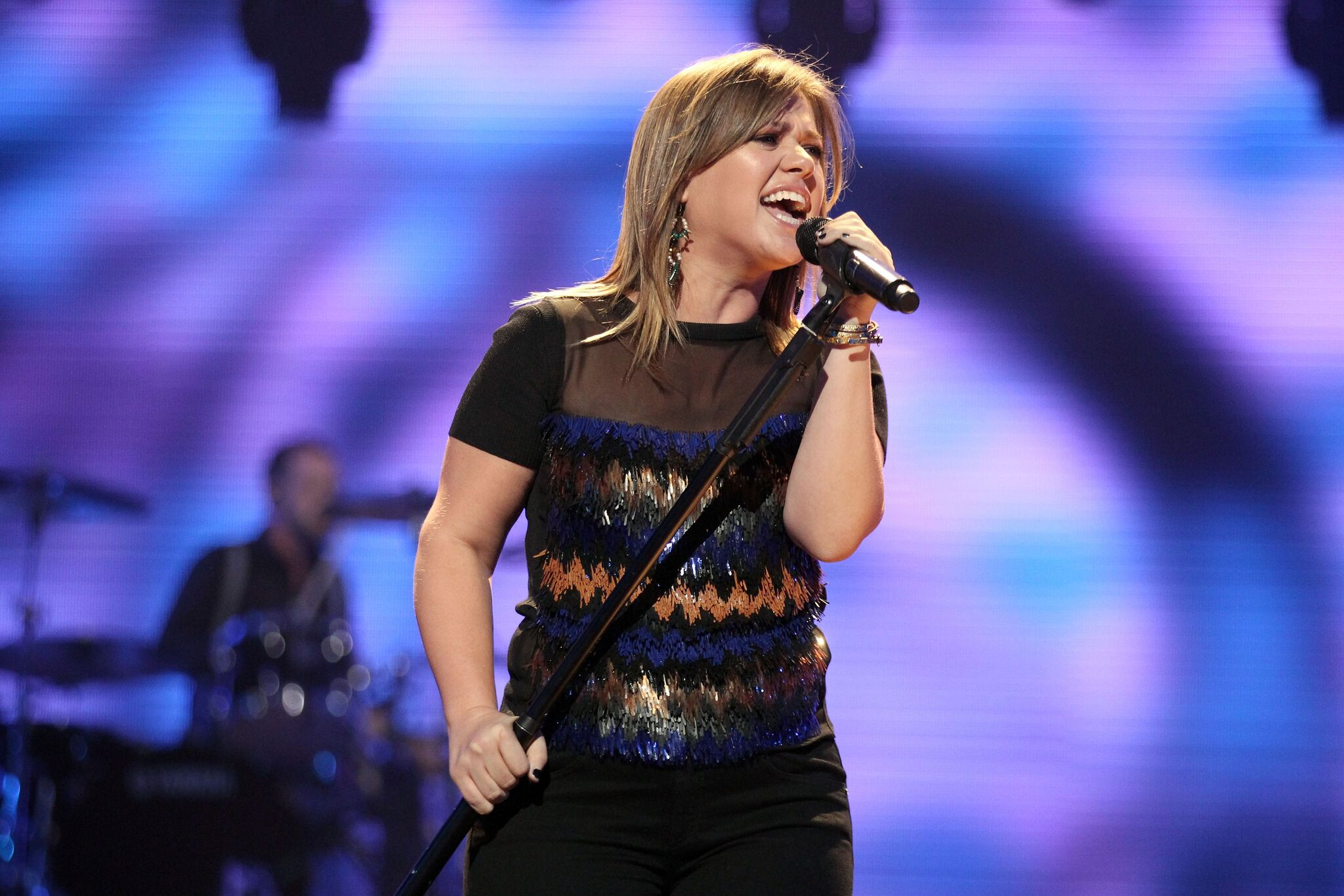Kelly Clarkson performs onstage at the iHeartRadio Music Festival | Getty Images