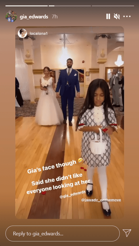 Patti LaBelle's granddaughter, Gia Edwards, pictured while on flower girl duties during a wedding ceremony | Photo:Instagram/gia_edwards