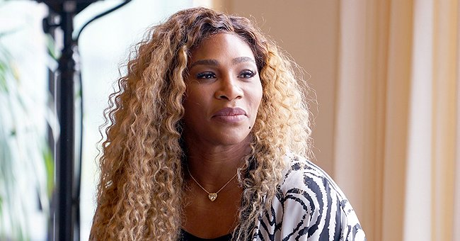 Serena Williams Flaunts Her Slim Waist in a Black Belted Swimsuit with a Vest & High Heels