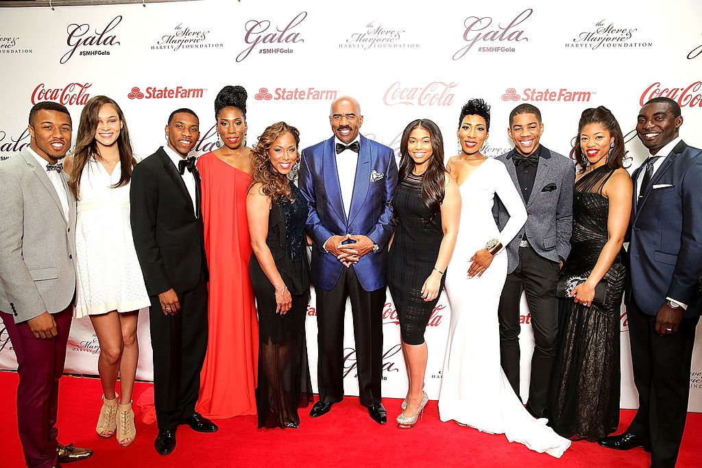 Steve and Marjorie Harvey with their children and their spouses at the Steve & Marjorie Harvey Foundation Gala, May 2014   Source: Getty Images