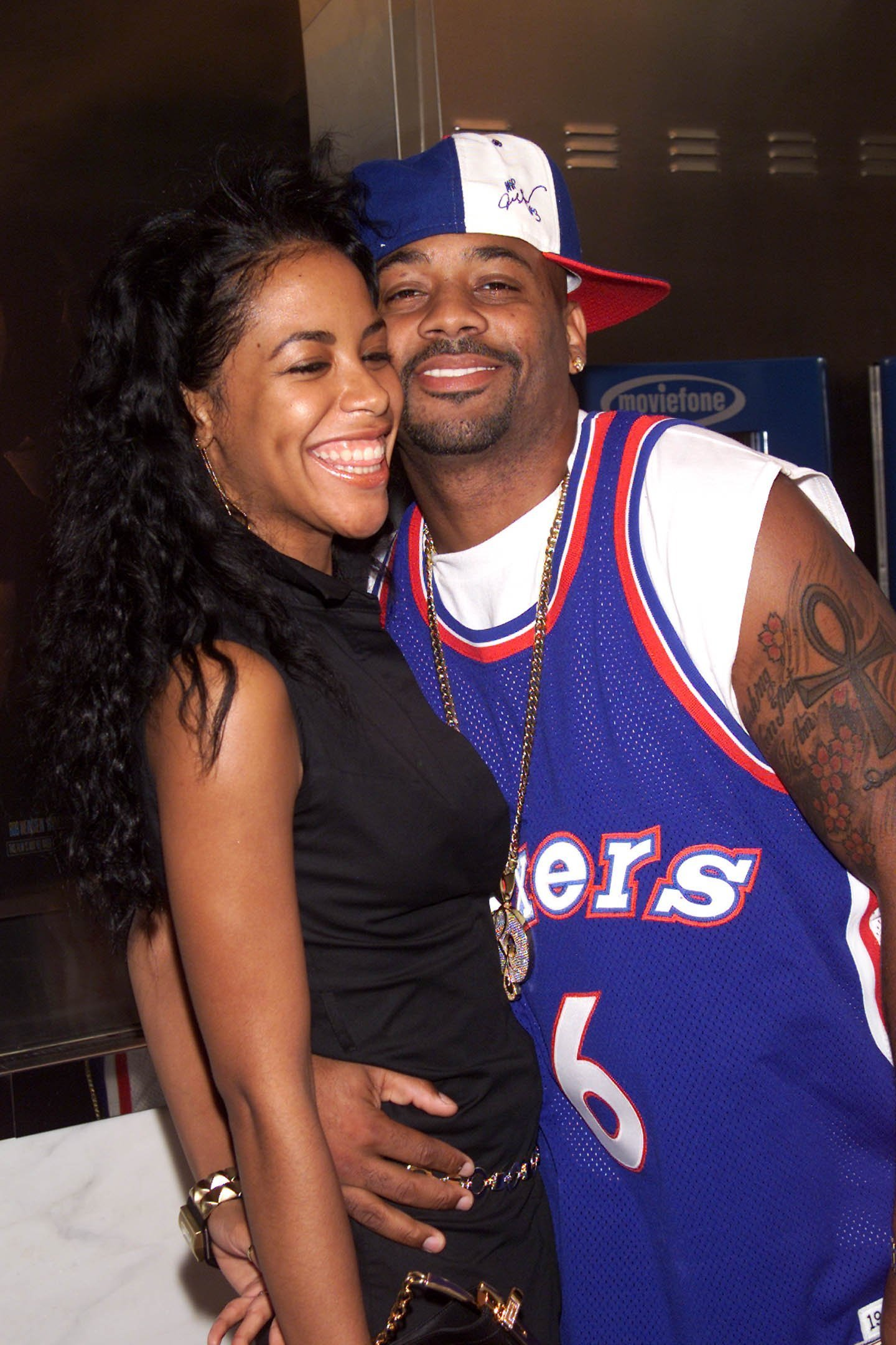"""Singer Aaliyah with boyfriend Damon Dash arrive at the World Premiere of """"The Others"""" at the Paris Theater in New York City. 