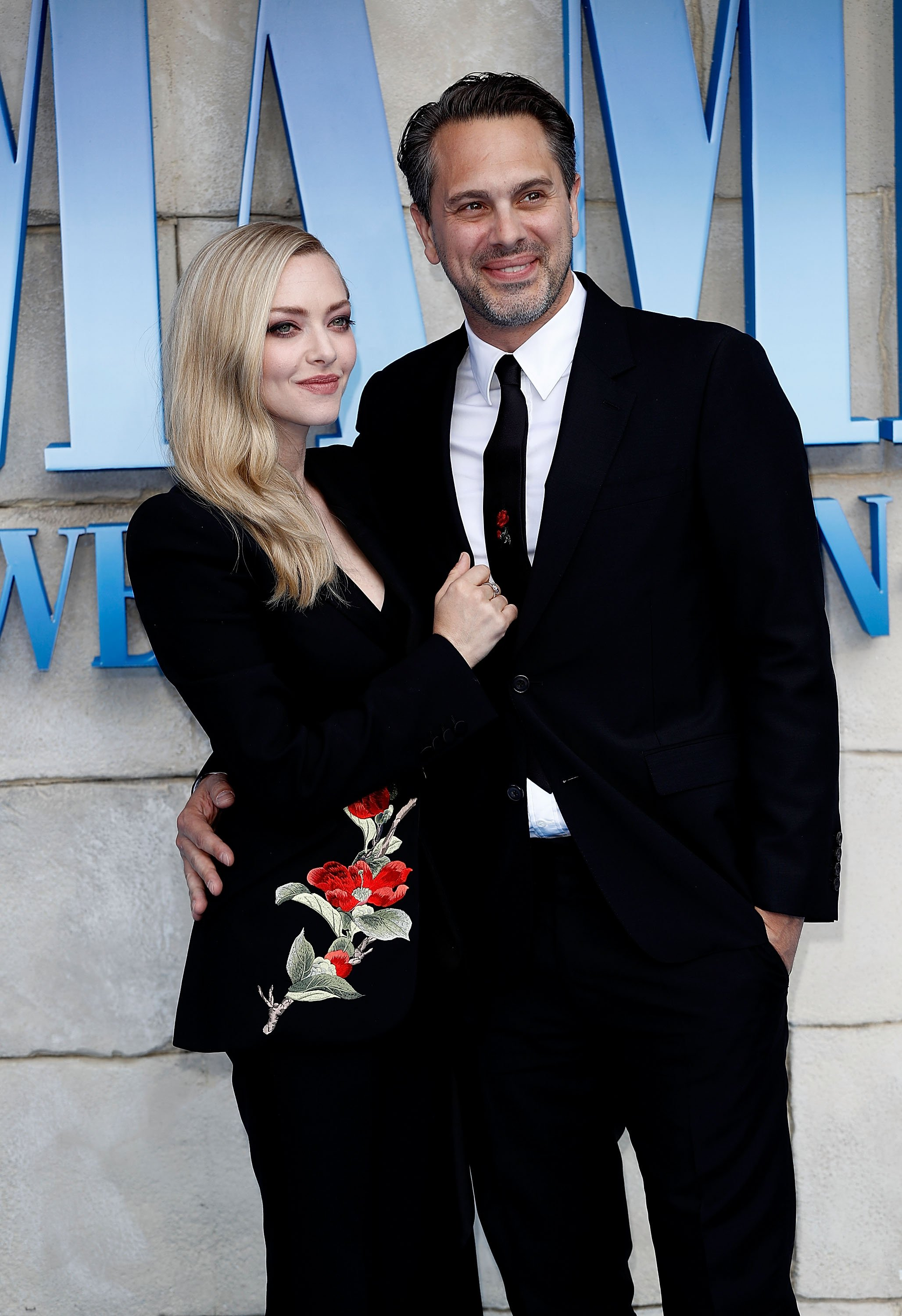 "Amanda Seyfried and Thomas Sadoski attend the UK Premiere of ""Mamma Mia! Here We Go Again"" at Eventim Apollo on July 16, 2018, in London, England. 