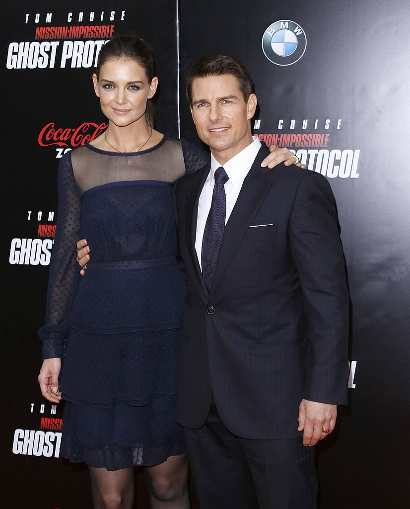 """Tom Cruise (R) and Katie Holmes attend the """"Mission: Impossible - Ghost Protocol"""" U.S. premiere at the Ziegfeld Theatre on December 19, 2011 