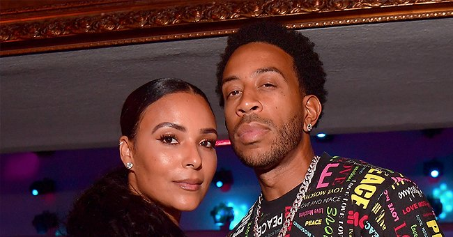 Ludacris' Wife Eudoxie Looks Stunning in a White Jumpsuit with a Matching Belt & Birkin Handbag