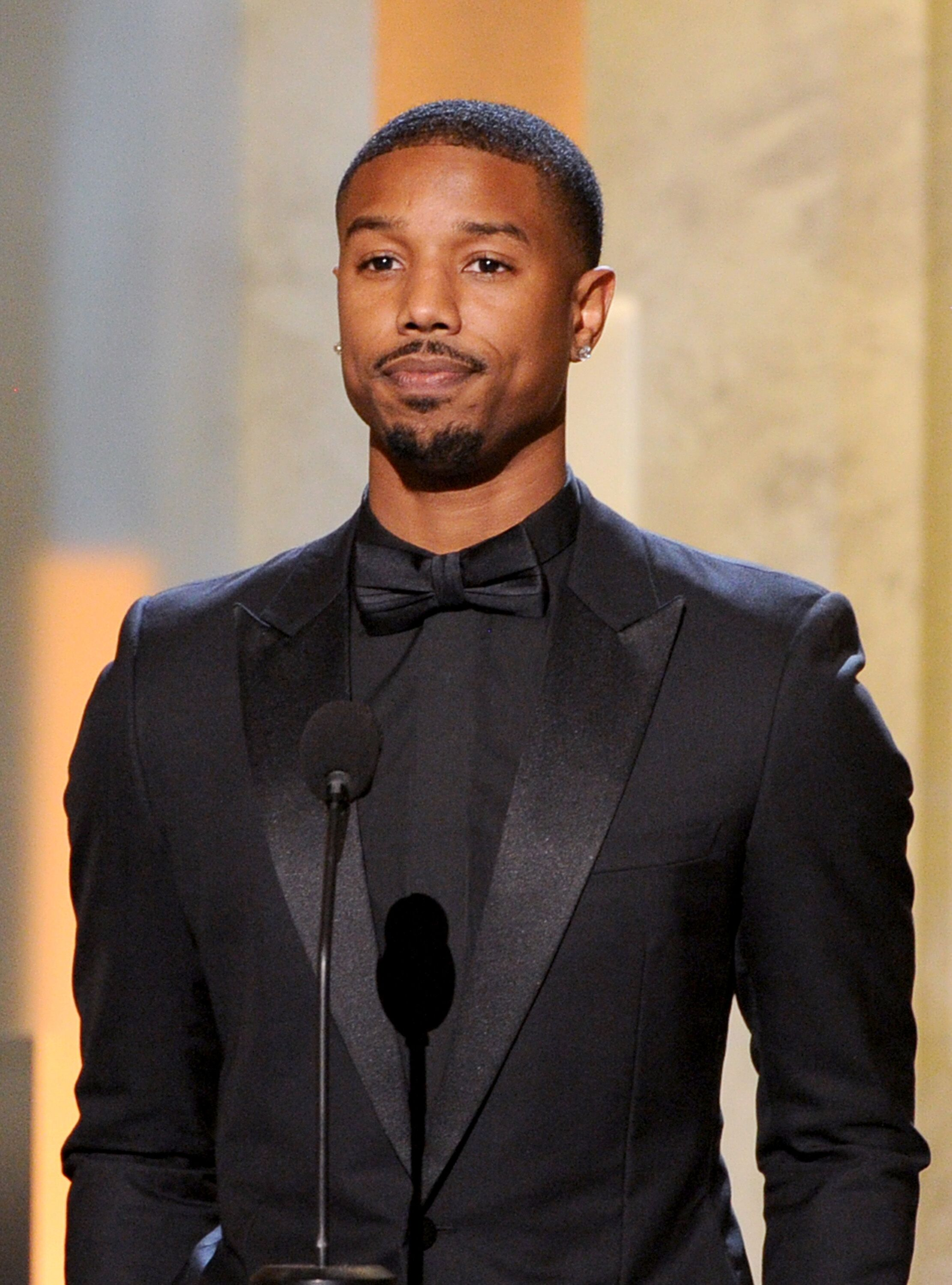 Actor Michael B. Jordan speaks onstage during the 45th NAACP Image Awards presented by TV One at Pasadena Civic Auditorium on February 22, 2014 in Pasadena, California | Photo: Getty Images