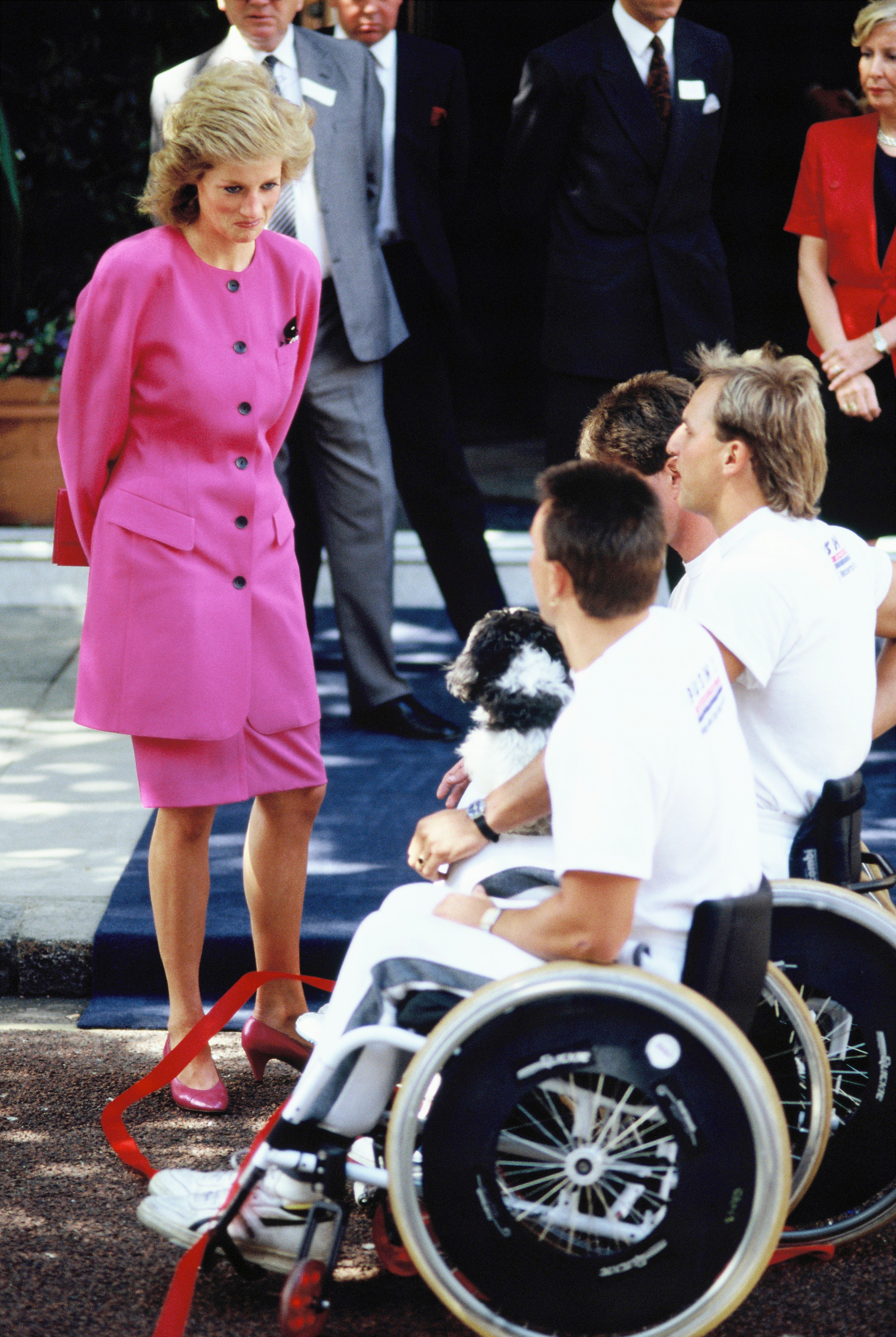 Diana, Princess of Wales, visits people in wheelchairs in 1988. | Source: Getty Images